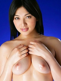 Saori Hara shows hairy pussy while fondling oiled boobies