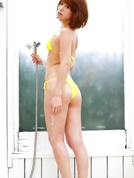Misato Kashiwagi in yellow lingerie rubs pussy of bench